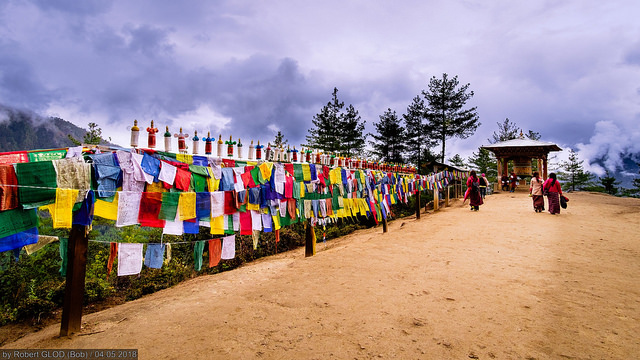 Prayer flags fluttering near Takstang Monastery