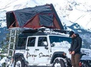 Drew Simms parked his jeep for outdoor camping in heavy snowfall, Oregon
