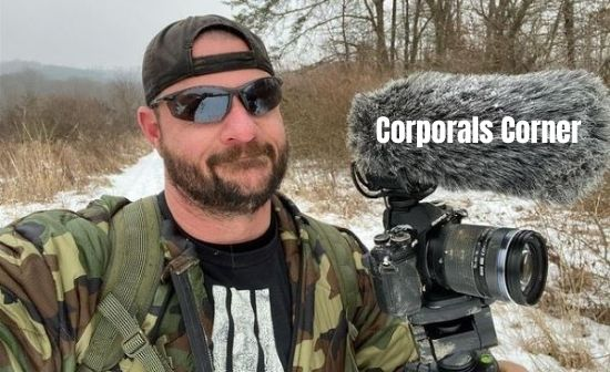 Corporals Corner with his vlogging camera in snowfall