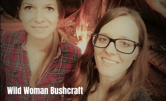 wild woman bushcraft Vanessa with survival Lilly in her bugout camp.