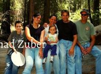 Chad Zuber with his wife Veronica along with three children in outdoor hiking
